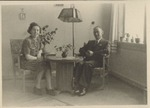 Photograph of Elisabeth & Roderich Wolff sitting by a table, June 1945