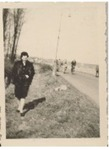 Photograph of Elisabeth Wolff walking near a street, undated